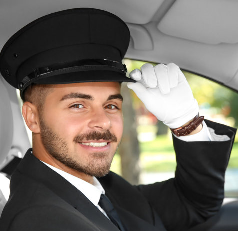 driver smiling while holding his cap